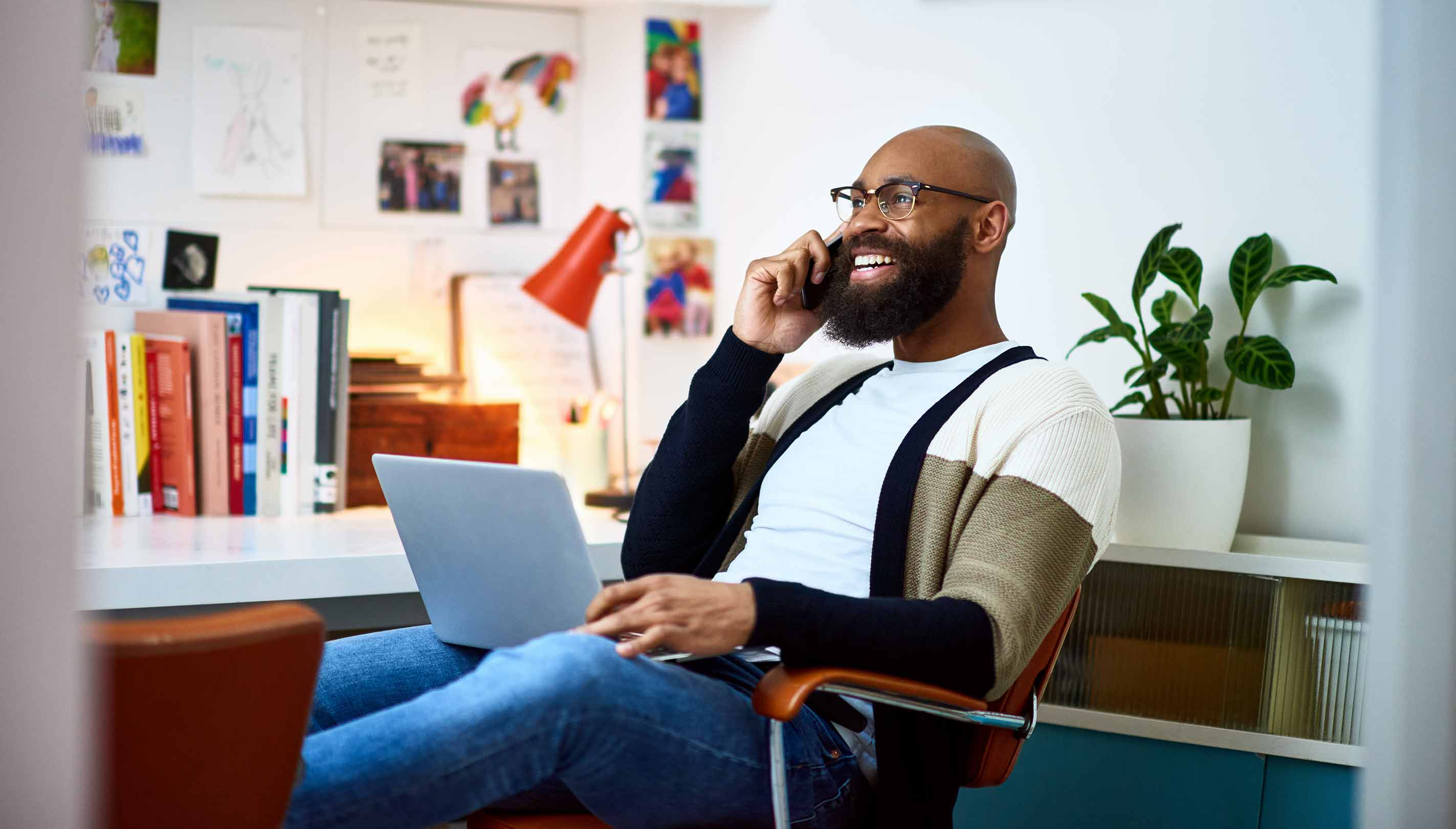 Man smiling as he works from a modern home office